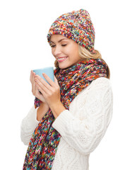 woman in hat with red tea or coffee mug