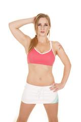 woman pink bra skirt hand head