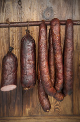 kind of sausage - wooden background