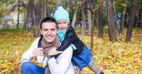 Portrait of Young father walking with his little cute daughter