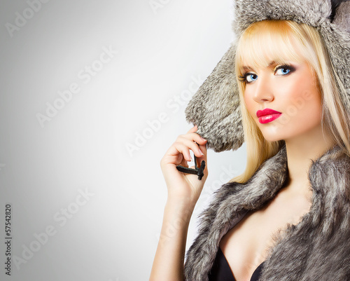 Beautiful girl in fur hat