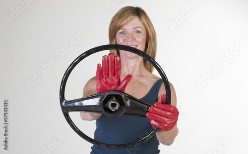 Woman driver at the wheel using the hooter