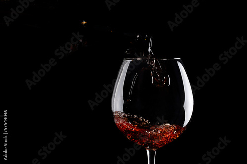 pour wine into a glass