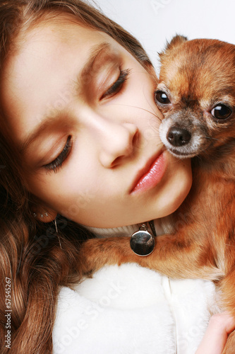 Portrait of a pretty girl and little dog