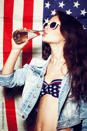 woman in sunglasses with national usa flag