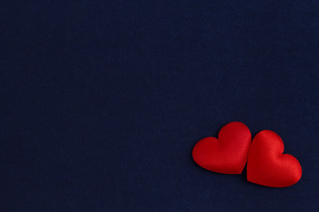 Two hearts on a blue velvet