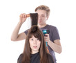 Woman enjoying having her hair blow dried
