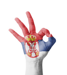 Hand making Ok sign, Serbia flag painted
