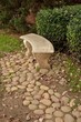 Park bench on stone path