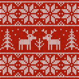 Red knitted sweater with deer seamless pattern