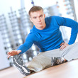 Man doing stretching exercises at the gym