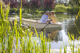 Couple hugging in rowboat on lake