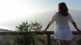 Young woman in the morning looking at the beautiful view