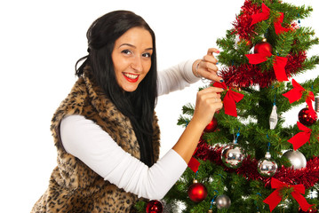 Happy woman decorate Christmas tree