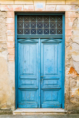 Old rustic wooden doors painted in blue