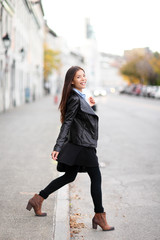 Fashion woman in city wearing urban leather jacket