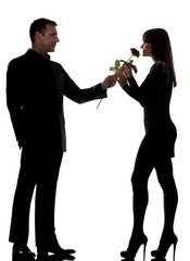 one couple man offering rose flower and woman smelling