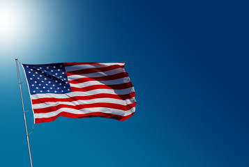 USA flag on blue sky