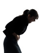 woman stomach pain cramp silhouette