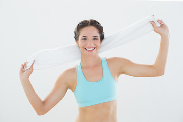 Portrait of a fit woman with towel around neck