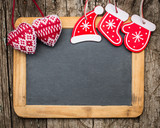 Christmas tree decorations on vintage wooden blackboard