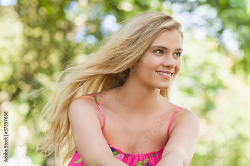 Beautiful casual woman sitting on a lawn