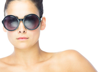Front view of brunette woman wearing gigantic round sunglasses