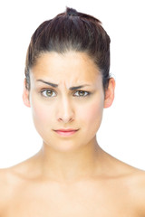 Front view of sceptical woman looking at camera