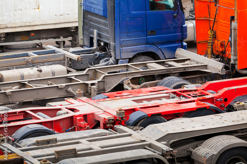 Abstract automotive transportation background with empty trucks