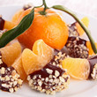 tangerine or mandarin fruit with chocolate sauce