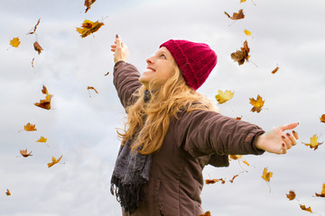 Young woman having fun in autumn
