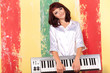 young woman with piano keyboard