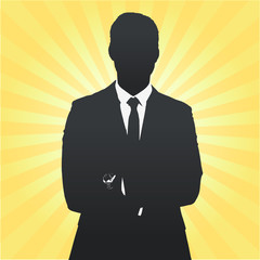 Silhouette of business man with his arms crossed