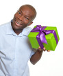 African man listening on a gift