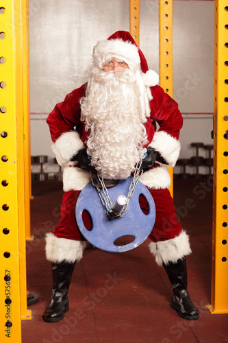 Santa Claus n training before Christams time in gym