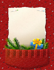 Blank paper for christmas list with gift in knitted pocket
