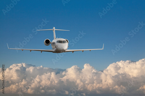 airplane above white clouds