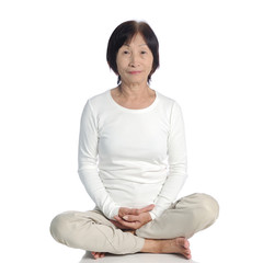 senior asian woman doing meditation in buddhism practice
