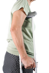 hand of senior woman holding crutches isolated