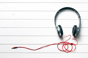 black headphones on white wooden table