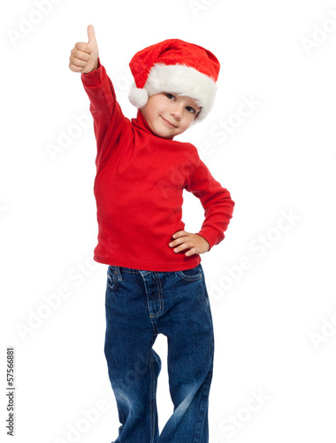 Boy in Santa hat with thumbs up sign
