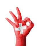 Hand making Ok sign, Switzerland flag painted