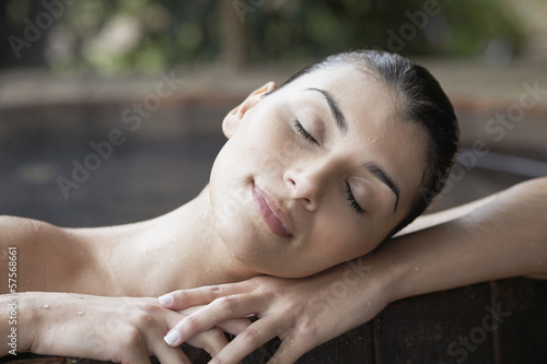 Young woman in Jacuzzi