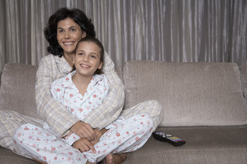 Mother and daughter watching TV
