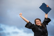 Pretty, young woman celebrating joyfully her graduation