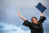 Pretty, young woman celebrating joyfully her graduation