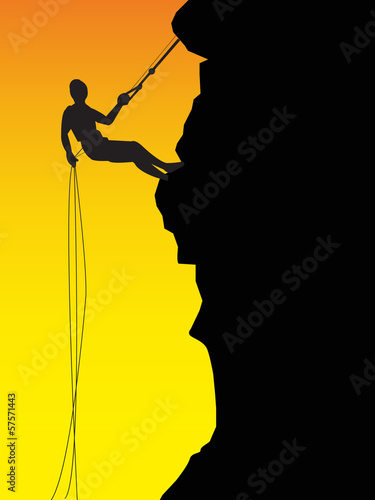 Silhouette of a rock with climbers