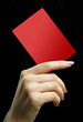レッドカードと女性の手