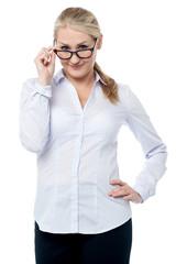 Flirtatious corporate woman staring you