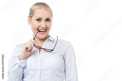 Mischievous smiling young corporate woman